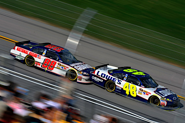 Dale Earnhardt Jr., driver of the No. 88 National Guard racecar, pushes or 'bump drafts' teammate Jimmie Johnson during the race at Talladega Superspeedway in Talladega, Ala. April 17, 2011. Earnhardt finished fourth and moved up three positions in the points race. (Photo courtesy of Hendrick Motor Sports)(Released)