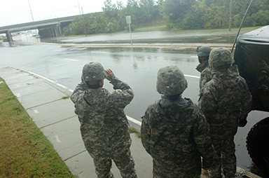 Virginia National Guard soldiers conduct reconnaissance patrols in support of Hurricane Sandy operations Oct. 29, 2012, in Norfolk, Va.