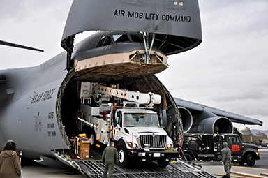 Air Force crews offload Southern California Edison power repair equipment from a C-5 Galaxy on Stewart Air National Guard Base in Newburgh, N.Y., Nov. 1, 2012. The Defense Department initiated the airlift operation to aid recovery efforts in Hurricane Sandy's aftermath.