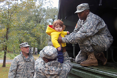 Virginia National Guard members rescued a child and several other flood victims Wednesday.