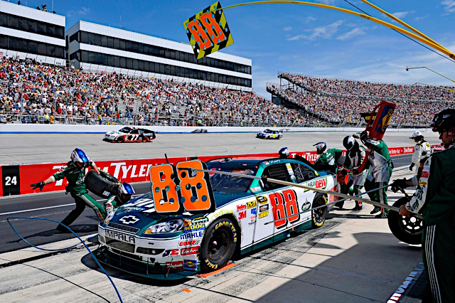 Dale Earnhardt Jr. and the No. 88 National Guard-sponsored NASCAR racecar team, work quickly to get their car out of pit row and back into the race Oct. 3 at Kansas Speedway, Kan. (Photo courtesy of Hendrick Motorsports) (Released)
