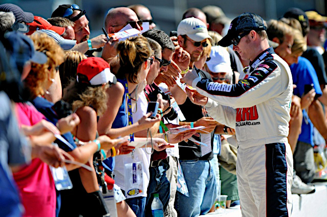 Dale Earnhardt Jr., driver of the No. 88 National Guard NASCAR racecar, signs autographs and greets the fans before race day at Michigan International Speedway in Brooklyn, Mich., Sunday Aug. 21, 2011. Earnhardt and the No. 88 National Guard crew sit in ninth place in the Sprint Cup championship standings with only three races left before the chase for the cup. (Photo courtesy of Hendrick Motor Sports)