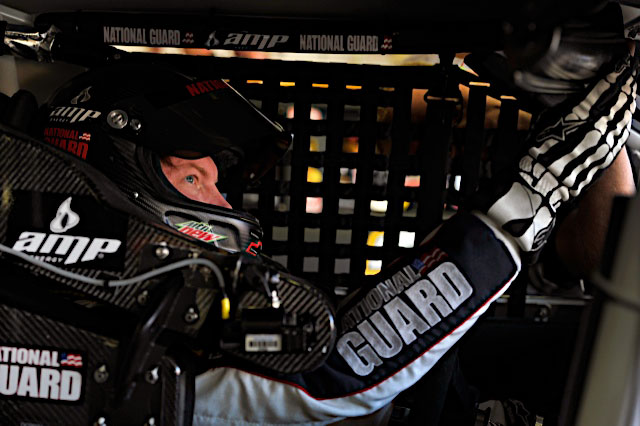 Dale Earnhardt Jr., driver of the No. 88 National Guard NASCAR racecar, does pre-race checks before the official start of the race at New Hampshire Motor Speedway in Loudon, N.H. July 17, 2011. Earnhardt now sits in ninth place in the NASCAR Sprint Cup Series points chase, two slots away from dropping out of the chase. (Photo courtesy of Hendrick Motor Sports)(Released)
