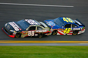 Dale Earnhardt Jr., driver of the No. 88 National Guard NASCAR racecar, 'bump drafts' with teammate Jimmie Johnson around the Daytona International Speedway in Daytona Beach, Fl. July 2, 2011. Earnhardt was caught up in a final lap wreck and crossed the finish line 19th. (Photo courtesy of Hendrick Motor Sports)