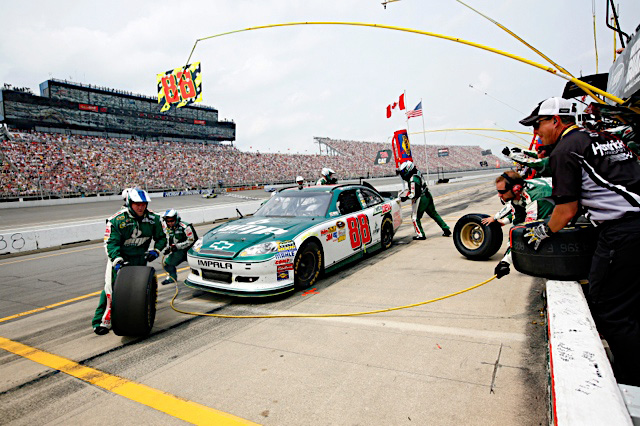 Dale Earnhardt Jr., driver of the No. 88 National Guard NASCAR racecar, sits in his pit box as the No. 88 pit crew rushes to get the National Guard NASCAR racecar back into the race at Michigan International Speedway in Brooklyn, Mich., Sunday June 19, 2011. (Photo courtesy of Hendrick Motor Sports)(Released)