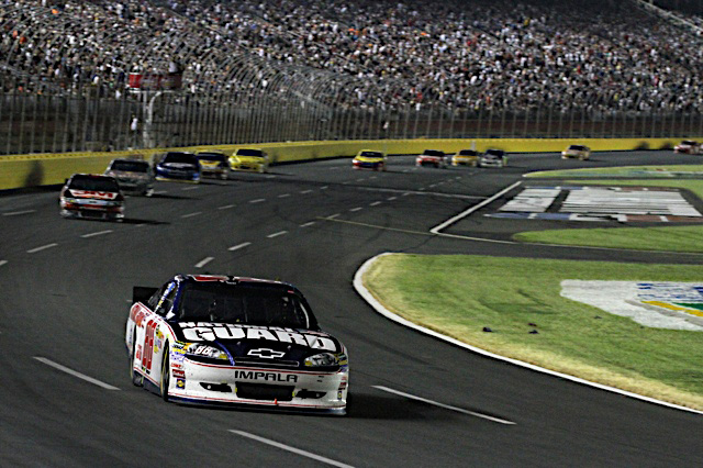 Dale Earnhardt Jr., driver of the No. 88 National Guard NASCAR racecar, leads the race on its final laps just before running out of fuel with only have a lap to go at Charlotte Motor Speedway in Concord, N.C. Dale Jr. remains in fourth place in the Sprint Cup series points race. (Photo courtesy of Hendrick Motor Sports)