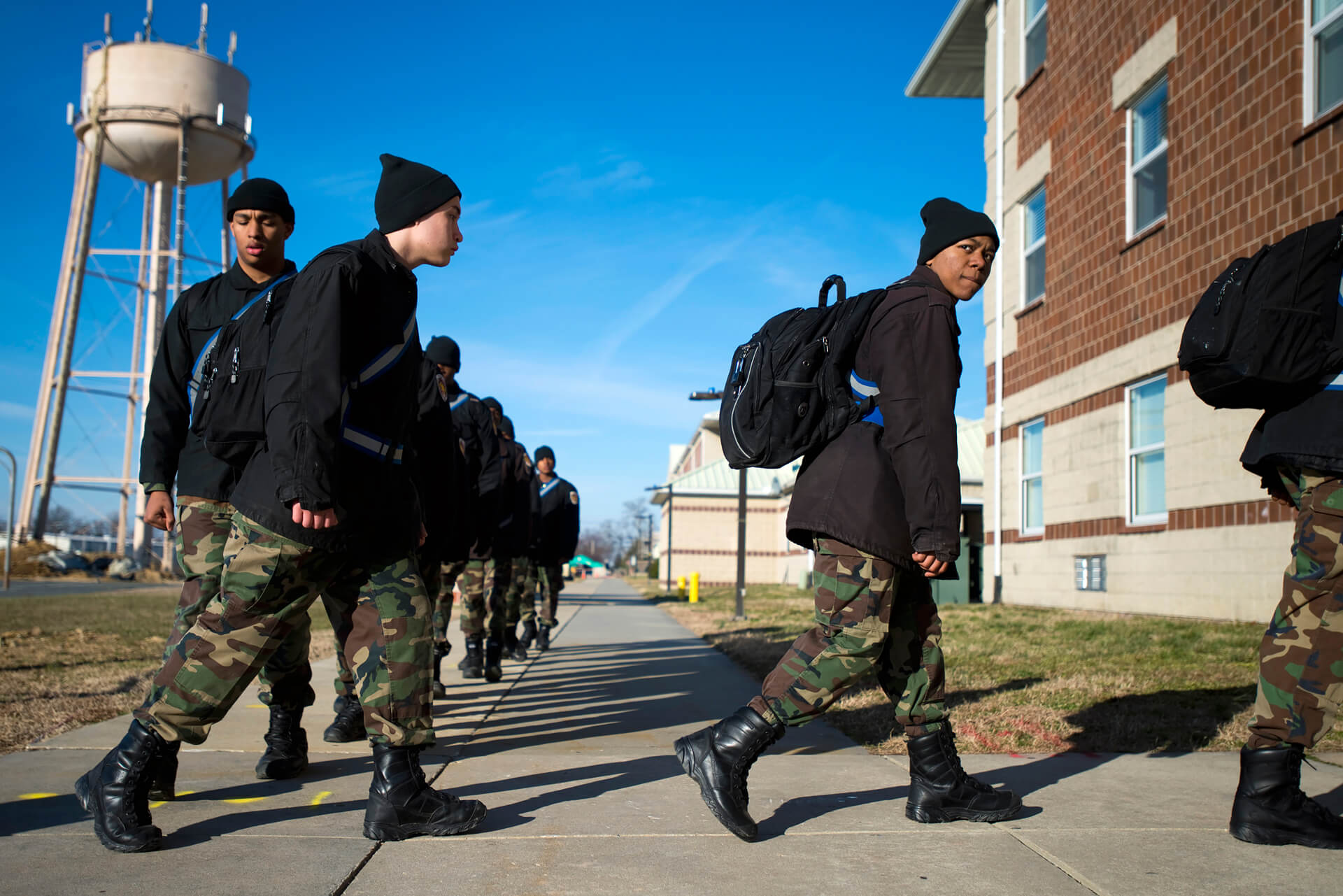 Cadets march single file into the academy's classroom building to begin the school day.