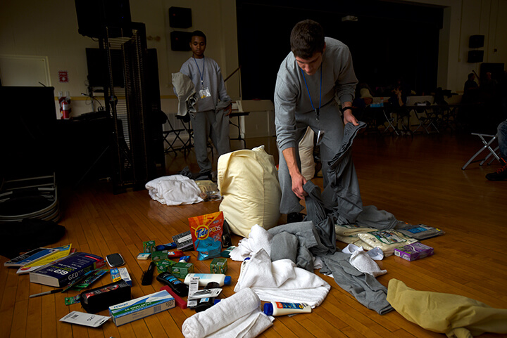 Joshua Griffin and other candidates rummage through their belongings during a shakedown inspection.