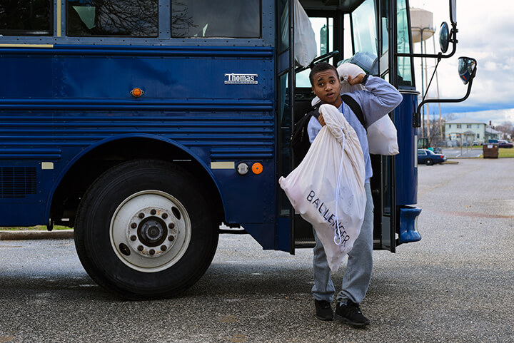 Ricardo Ballenger steps off a bus outside the Freestate Academy.
