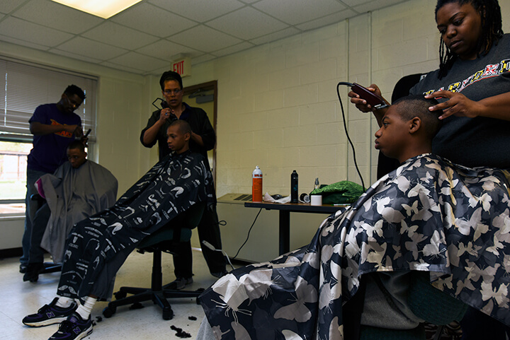 Candidates get new haircuts, one of the first orders of business after arriving at the academy.