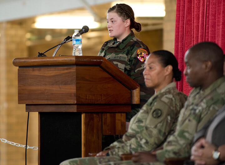 Alexis Head, a cadet at the Freestate Academy, gives a commencement speech as part of the ceremony. Alexis, along with fellow cadet D'Wight Lucas, shared her personal story of triumph and success with the packed crowd of family, peers and mentors.