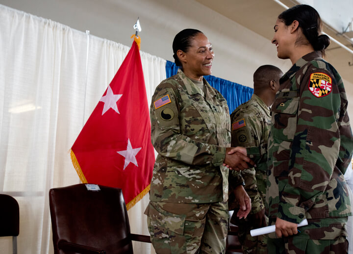 Army Maj. Gen. Linda Singh, left, the adjutant general of the Maryland National Guard, congratulates Laneesha Johnson on graduating from the academy.