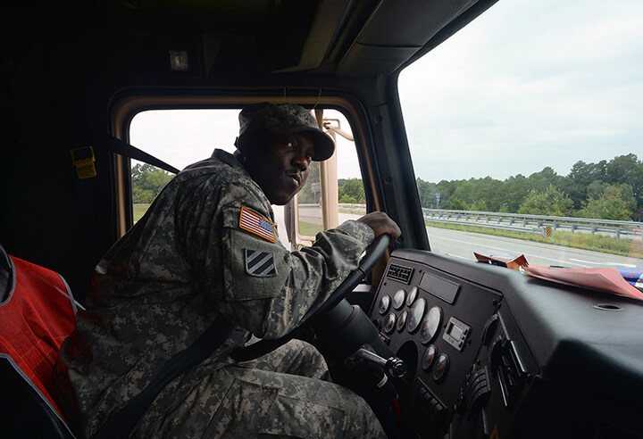 Army Sgt. Michael Davis looks for oncoming traffic while exiting an Interstate 95 offramp in North Carolina.