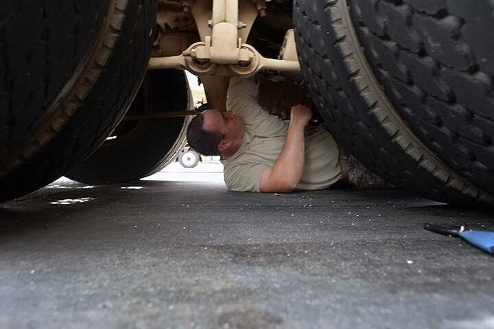 Army Sgt. Richard Johnson replaces a rubber seal on the air brakes of his truck during a fuel stop in South Carolina.