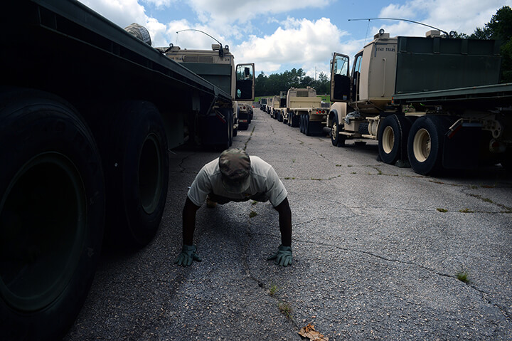 Army Sgt. Charles Wallace takes a break from readying his truck for the convoy.
