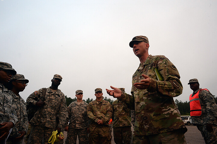 Army Capt. Derek Ellison gives a pep talk to Soldiers in the unit while taking part in the convoy.