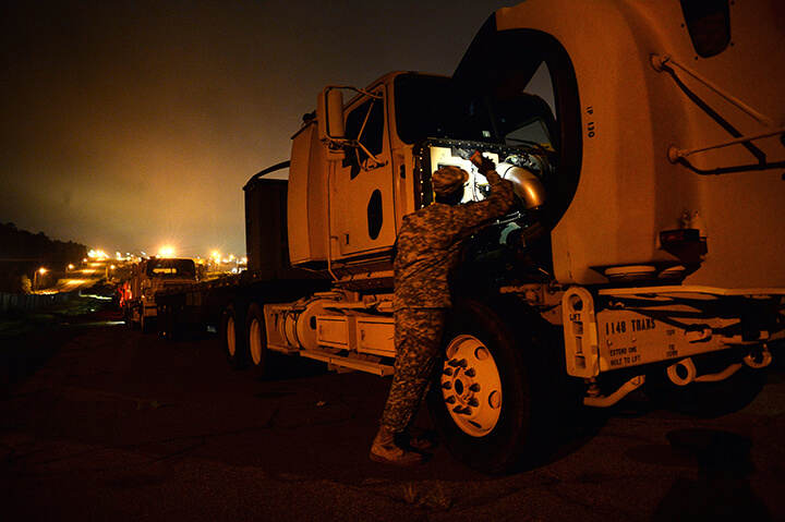 Spc. Craig Elliott performs preventative maintenance checks on his truck prior to heading out.