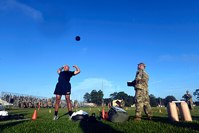 Cpl. Troy Perez, a fire team leader with the New York Army National Guard's Alpha Company, 1st Battalion, 69th Infantry Regiment, heaves a 10-pound medicine ball during the first event of the competition. This portion of the event — called the Standing Power Throw — is part of the Army Combat Fitness Test, which made its debut in last year's competition.