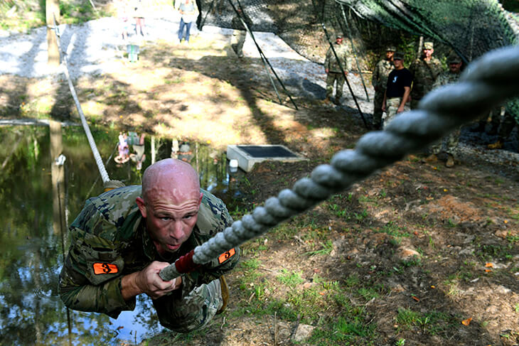 Staff Sgt. Mitchell Scofield, slowly pulls himself to a marker (not pictured) on a rope during the commando's crawl portion of an obstacle course event at the Army National Guard's 2020 Best Warrior Competition at Camp Shelby, Mississippi, Sept. 16. Scofield, a cavalry scout and instructor at the Mississippi Army National Guard's Regional Training Institute, would earn Noncommissioned Officer of the Year honors in the competition, which took place Sept. 13-16.