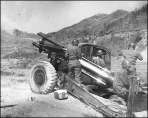 Oklahoma's Battery B, 189th Field Artillery, 45th Infantry Division fires its 155mm howitzers on a mission to help stem the Communist Chinese assault.