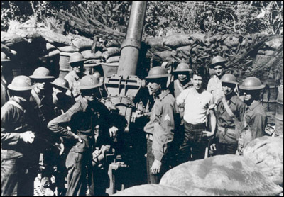 Soldiers from the 200th Coast Artillery Regiment, New Mexico National Guard, pictured with anti-aircraft artillery gun during Bataan campaign being fought in the Philippines in early 1942.  Photo by National Archives.