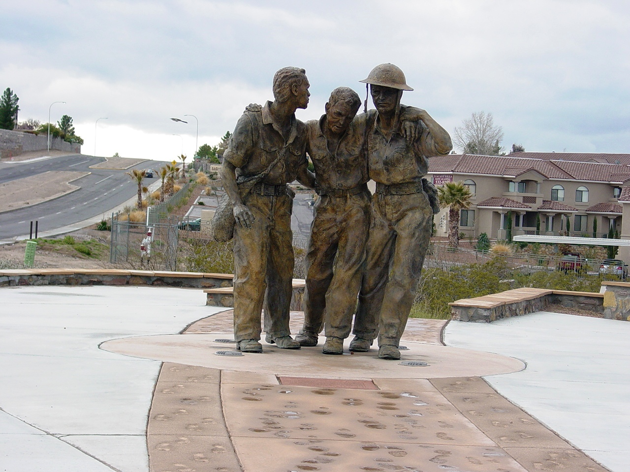 Statue of Bataan Death March walkers, located at Veterans Memorial Park, Las Cruces, N.M. This monument, the first nationally-funded shrine to the Death March, was dedicated in April 2002, and displays actual footprints of Bataan survivors.