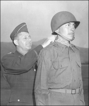 First Lieutenant Ernest Childers receives his Medal of Honor from Lieutenant General Jacobs L. Devers, at a special awards ceremony in Naples, Italy.