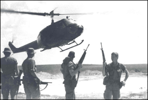 Members of the Indiana Rangers await their 'ride' into hostile territory by a UH-1 'Huey' helicopter. This was their normal mode of transportation in and out of action during their one year tour in Vietnam.