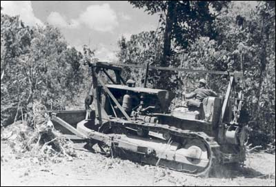 A bulldozer of Mississippi's 106th Engineer Battalion