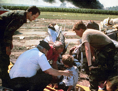 Airmen from the 185th Tactical Fighter Group (TFG), Iowa Air National Guard, tend to a victim of the crash of United Airlines Flight 232 in Sioux City, Ia., on July 19, 1989.