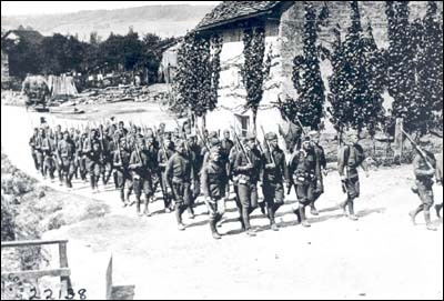 Members of the 117th Engineer Regiment marching behind the line near Meurcy Ferme, France in July 1918.