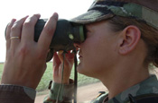 A U.S. Army Sgt., with 252nd Combined Arms Battalion, North Carolina Army National Guard, looks through binoculars near an area of the U.S.-Mexican border in San Luis, Ariz., July 27, 2006. The Soldiers are currently working with the U.S. Border Patrol in support of Operation Jump Start. (U.S. Air Force photo by Tech. Sgt. Brian E. Christiansen) (Released)