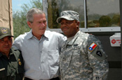 President George Bush talks with a Texas Army National Guard Soldier at a border observation point while visiting National Guard troops who are participating in Operation Jump Start at the U.S. Mexican border in Mission, Texas, on Aug. 3, 2006. (Photo by Sgt. Jim Greenhill, National Guard Bureau)